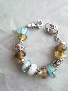 Beach colours: turquoise, gold #trollbeads