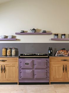 This purple on the cabinets? With medium grey floors and white walls. 14 Creative Ways to Decorate a Kitchen With Purple Purple Kitchen Cabinets, Purple Kitchen Decor, Purple Kitchen Designs, Lavender Kitchen, Kitchen Decor Items, Kitchen Colors, Purple Kitchen Walls, Kitchen Shelves, Updated Kitchen