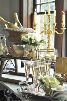 Use wooden sled for buffet vignette for party- fresh flowers,urns used as ice buckets, vintage dishes and candlelight