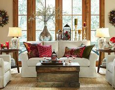 Love the mercury lamps and oversized vase, alongside the rustic coffee table.