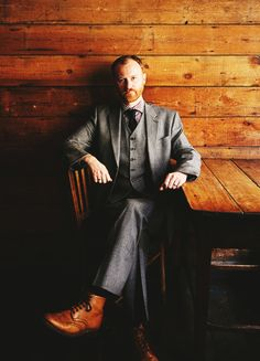 Mark Gatiss,....his shoes match the backdrop.