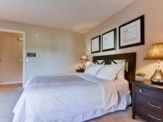 Light colored bedroom and dark colored furniture... Simple yet fantastic design for a Carmel Valley home bedroom.