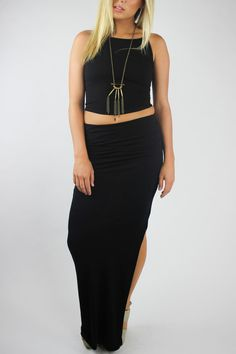 """Who doesn't need a basic black maxi skirt in their closet? This version from Bobi Los Angeles can take you from day to night with its form fitting silhouette and subtle ruching on the hips. Unlined skirtfeatures an elasticized banded waist, ruched sides, and a side seam slit. Basic enough to wear with just about anything, but we love it with a sexy cropped tank and chunky boho necklace!    Measures: 44"""" L   Ruched Maxi Skirt by Bobi Los Angeles. Clothing - Skirts - Maxi California"""