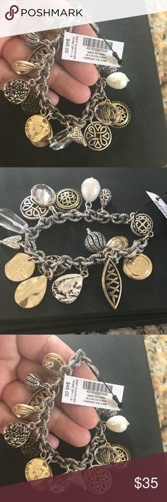 NWT CHICOS Silver & gold charm bracelet!! NWT CHICOS beautiful silver & gold charm bracelet!!!  Special charm brand new will be included. Check out last few photos Chico's Jewelry Bracelets