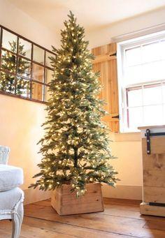 a handmade Christmas tree base made of wood