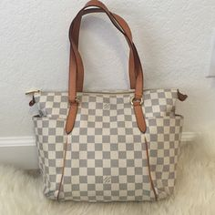 """Louis Vuitton """"totally pm"""" damier azure In good used condition, date code found in outer pocket! Some curling to side tags as shown and blue discoloration to interior (have not attempted to clean) another listing added with corner pictures. Two interior pockets. This is the pm (smaller size) any questions feel free to ask! I always compare my bags to yoogi closet on ebay! She is A-mazing at collection listings.. This is her link…"""