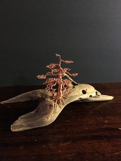 Copper Wire Miniature Bonsai Mounted on Driftwood. Each bonsai creation is hand made by me; thus, each one is unique and different. No 2 are ever alike. I start with many strands of copper wire [usually 22 gauge], then bend, turn, and twist it to create a unique, beautiful bonsai tree. I then mount the tree on a piece of driftwood which can be displayed and placed on a desk, dresser, stand, etc. to add a beautiful and unique touch to your room or office. These creations are perfect for…