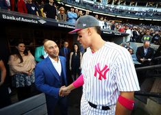 Past meet present. Jeter and Aaron Judge exchange pleasantries before the game. -- Al Bello, Getty Images -- 5-14-17
