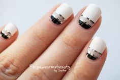 black, grey and white nails with silver stripe.
