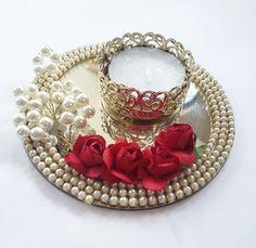 This listing is for 2 diyas. It had a mirror base with pearl and rose embellishments. Diwali Diya, Diwali Craft, Diwali Gifts, Diwali Candle Holders, Diwali Candles, Diwali Decoration Items, Thali Decoration Ideas, Desi Wedding Decor, Wedding Crafts