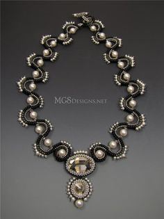 I'm used to seeing this in peach- like the grey better! sinusoidal necklace by Melissa Grakowsky