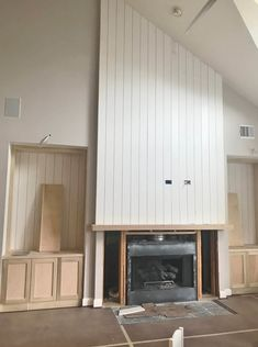IN PROGRESS - This new fireplace wall has vertical paneling and symmetrical built-ins on each side for a cleaner look. We'll have two library arm type light fixtures above the built-ins to illuminate the open shelving on each side. Wood Mantle Fireplace, Brick Fireplace Makeover, Fireplace Built Ins, Farmhouse Fireplace, Fireplace Remodel, Fireplace Design, Fireplace Ideas, Fireplace Refacing, Mantle Ideas