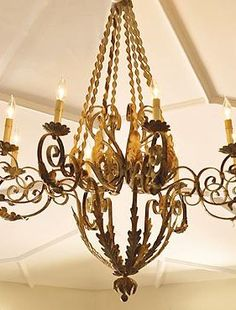 Reminiscent of traditional French design, the Twisted French Chandelier elegantly flaunts a scrolling and deep-ocean finish that gives the feel of an authentic, aged appearance.