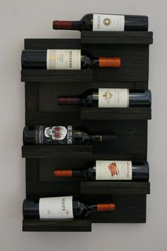 *****This is a MADE TO ORDER listing. You will receive a wine rack the same as the one pictured above but this one already has a home.***** For this listing you will receive a stunning wine rack just like the one shown above. You get to choose you stain color and your decorative mesh color. Its made out of poplar hard wood and this one is stained a beautiful Ebony but we have many more colors to choose from, you can see them in the 4th picture. There are 6 shelves for your bottles of wine…