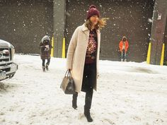 J.J. Martin managed to show off her style, even in the snow, with a printed sweater. Source: Tim Regas