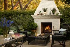 I will need a huge yard to incorporate all these fun outdoor fire place ideas.