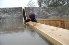 """""""Moses Bridge"""" - The bridge is really invisible at a distance, you can see only visitors` heads above the water."""