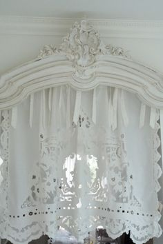 using random pieces of molding and trims from otherwise damage pieces of furniture to make window adornments.  Love this