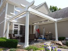 Construction - adding 17' motorized retractable awning (purchased off Craigslist for $600). Awning was disassembled and roll turned around, then awning installed upside down (arms on top). Works fine. Curved Pergola, Retractable Awning, Rainbow Light, Strip Lighting, Arms, Construction, Outdoor Structures, Led, Lights