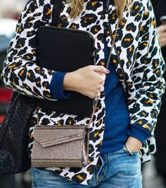 leopard jacket over a sweatshirt & jeans... that's my kind of style!
