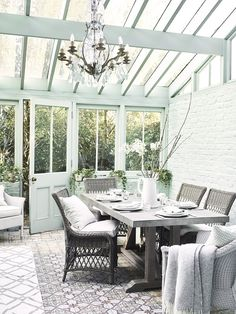 A Garden Room Filled with Plants and a chandelier