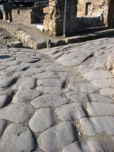 How many thousands of carts must have passed along the streets to make those ruts, in the ruins of Pompeii?