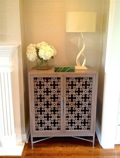 Love the height! Love the detail. Potentially customize color...Custom Project-Media Cabinet featurning Laser Cut Panel Doors
