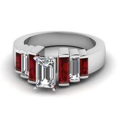 Enagement Ring With Emerald Cut Diamond With Diamond And Ruby Baguette Side Stones