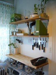 "Strips and hooks for the kitchen. Check out the knives and spoons!    Top tips for organizing your apartment from the Smarter Renter blog by Steve Brown Apartments. Beautiful apartments in Madison, WI. We can't wait to have you call our Madison apartments ""home."""