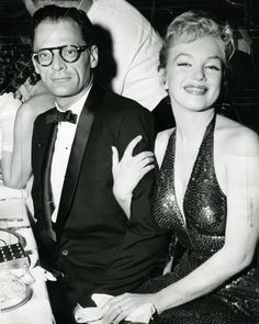 """Marilyn Monroe and Arthur Miller at the """"April in Paris Ball"""", in the Grand Ballroom of the Waldorf, 1957."""