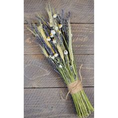 Newly harvested wheat and dried flowers make up this Rustic Farmhouse Lavender Bunch. Brand New bouquet design exclusive to our store. Makes a beautiful wedding bouquet! Order today to get the sale price! www.curiouscountrycreations.com #homedecor #driedflowers #driedwheat #weddinginspiration #weddingbouquet #farmhouse #falldecor