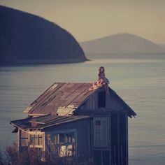 Oleg Oprisco Fine Art Photography - sitting on the roof