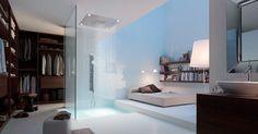 Cette suite parentale minimale mise sur l'ouverture des espaces. Le + : la douche au milieu de l'espace donne une impression d'espace http://www.edifit.fr #SuiteParentaleModerne #SuiteParentaleMinimale