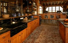 A nice timber frame kitchen with a Herringbone patterned floor.