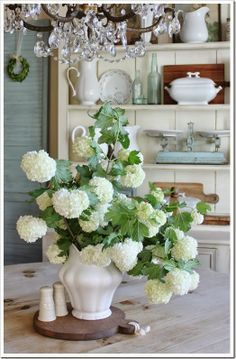 I wish links were just embedded in photo's.  here is the link to my blog post if you see this photo out there!  http://fishtailcottage.blogspot.com/2014/05/snowbell-shrubs.html