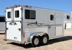 """4-Star 2H Straight Load """"Thoroughbred"""" Model gooseneck. Rear ramp with dutch doors, two straight stalls that are 132"""" long, full height door with windows at the head of each horse and a 48"""" dressing room with carpet and great tack storage!"""