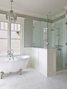 Walk In Shower. tub by windows. wall paneling. glass. exposed plumbing.