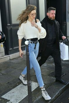 white cropped knit + jeans + belt + white walkers /Gigi Hadid