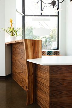 Mitre wrapped madrone salvaged from Hillsboro compliments the black walnut paneling. Hand rubbed oil warms the madrone to a silk smooth finish.