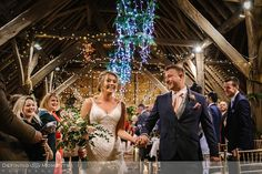 documentary wedding photography of bride and groom just after their civil wedding ceremony in the main barn at gildings barns in newdigate, a rustic countryside wedding venue in surrey with fairy lights Wedding Venues Surrey, Hotel Wedding Venues, Barn Wedding Venue, Wedding Ceremony, Wedding Photography Styles, Documentary Wedding Photography, Wedding Entourage, Dance Floor Wedding, Countryside Wedding