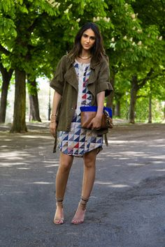 Soraya Bakthiar: patchwork shirt dress, olive parka, 2 tone clutch, strappy sandals.