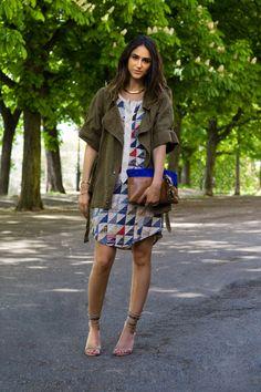 Soraya Bakthiar: patchwork shirt dress, olive parka, 2 tone clutch, strappy sandals.
