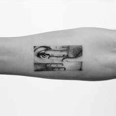 Piero Fornasetti's artwork inspired tattoo on the right inner forearm.