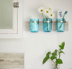 Tutorial shows you how to make this Coastal Mason Jar Organizer DIY. An upcycling craft in honor of Earth Month!