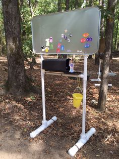 This is an oil drip pan mounted to a stand.  We use the mailbox to store our magnetic activity.  Each interactive board is tall enough to use with varying size horses and riders.