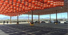 Repurposed traffic barrels activate a forgotten parking lot in Texas. The hanging barrels create swaying patterns of light and shadow, adding interest into a underused public space. Art Transportation, Urban Intervention, Space Architecture, Public Art, Public Spaces, Green Building, Light And Shadow, Innovation, Landscape