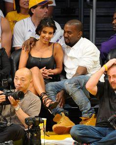 Pin for Later: Kim Kardashian, de Party Girl à Hot Mama  Kim et Kanyer a un match des LA Lakers en Mai 2012.