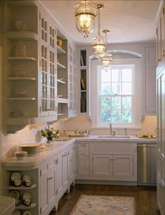 Like the feet on the lower cabinets, arch over the window, shelves between the glass fronted upper cabinets