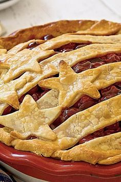 Break out your red, white, and blue; this patriotic cherry pie is topped with stars and stripes, making it the perfect end-of-dinner treat on July 4th, Labor Day, Memorial Day, or just about any other night on which you want to celebrate the USA. Have a slice and enjoy.#summerrecipes #summerdishes #recipes #summerfood #summerrecipeideas