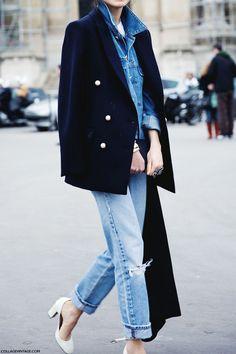 Denim on denim in boyfriend jeans, a chambray shirt and white pumps.